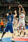 Real Madrid´s Facundo Campazzo and Anadolu Efes´s Dario Saric during 2014-15 Euroleague Basketball match between Real Madrid and Anadolu Efes at Palacio de los Deportes stadium in Madrid, Spain. December 18, 2014. (ALTERPHOTOS/Luis Fernandez)