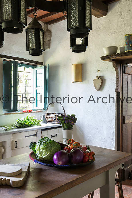 Arts and Crafts lanterns and Carrara marble worktops in the kitchen.