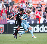 Jacob Peterson (37) of Sporting Kansas City collides on a header with Daniel Woolard (21) of D.C. United during a Major League Soccer match at RFK Stadium in Washington, DC.  D.C. United tied Sporting Kansas City, 1-1.