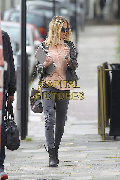 Sarah Harding in Primrose Hill, London, England..July 31st, 2012.full length black jacket silver tassels beads beaded grey gray jeans denim pink shirt  top sunglasses shades boots carrying holding laptop computer bag purse peach.CAP/HIL.©John Hillcoat/Capital Pictures .