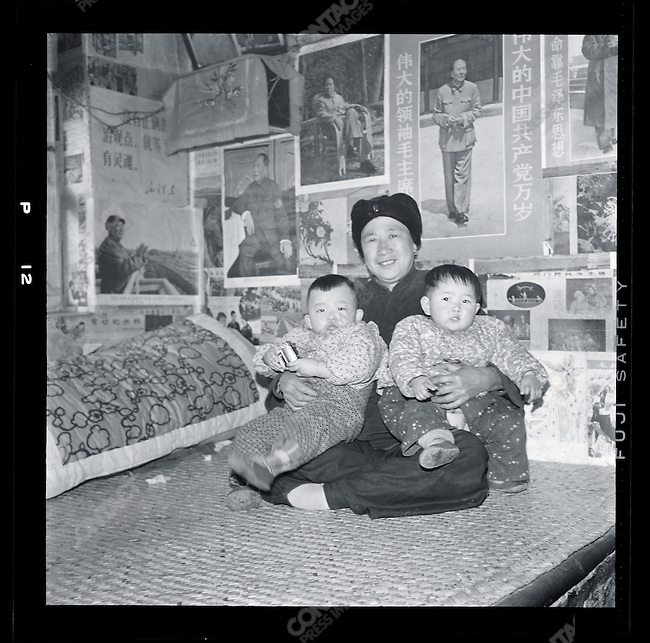Li Zhensheng's mother holding her grandchildren, Rongcheng county, Shangdong province, March 25, 1970.
