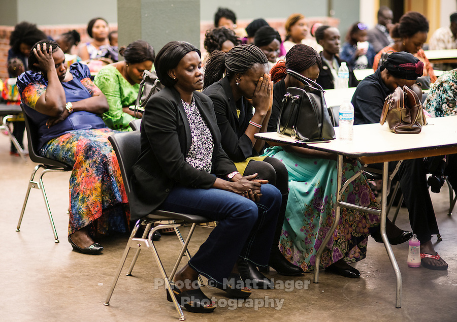Mary Kuanen attends a church event at the Hip Hop Church of Denver in Denver, Colorado, Saturday, October 22, 2016. Kuanen a refugee from Sudan moved to Denver 11 years ago with her husband and children. Five years ago her husband was murdered in a mistaken identity gang shooting. <br /> <br /> Photo by Matt Nager