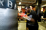 Phillip Jackson-Benson of South Jamaica, Queens, is 21 years old and has been boxing for 3 years. He fought last year in the Golden Gloves but lost in a 2nd round split decision. Hitting the super heavy bag in 2 minute rounds..Gleason's Gym has continued its long standing tradition in the boxing world as a training ground of competitors by putting 5 fighters into the finals of the 2006 Golden Gloves amateur boxing competition.. An inside look at the last 10 days of training for the 5 young fighters.