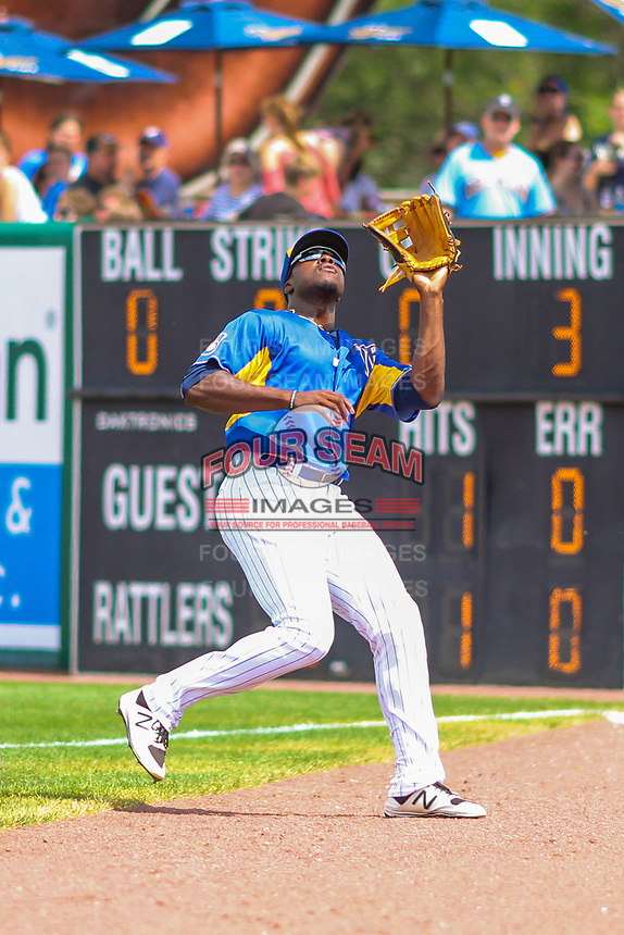 Wisconsin Timber Rattlers outfielder Demi Orimoloye (6) catches a ball in foul territory during a Midwest League game against the Cedar Rapids Kernels on August 6, 2017 at Fox Cities Stadium in Appleton, Wisconsin.  Cedar Rapids defeated Wisconsin 4-0. (Brad Krause/Four Seam Images)