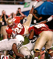Unintended Acrobatics:  FSU's Lorenzo Booker is upended by Penn State defenders for a loss on the play during the third quarter of the 2006 FedEx Orange Bowl.