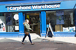 The Carphone Warehouse shop shopper walking in street, Tavern Street, Ipswich, Suffolk, England, UK