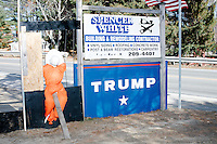"""Next to a sign for Spencer White Building and Remodeling Contractor and a Trump campaign sign, an effigy of Democratic presidential nominee Hillary Clinton appears to be in jail and surround by the words """"Lock her up!!,"""" """"Corrupt / CNN, ABC, CBS, NBC,"""" and """"Handcuffed Together!! Stronger Together!!!"""" in Troy, New Hampshire, on Fri., Nov. 4, 2016."""