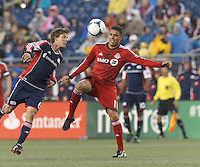 New England Revolution midfielder Scott Caldwell (6) heads the ball. Toronto FC forward Luis Silva (11). In a Major League Soccer (MLS) match, the New England Revolution (blue) defeated Toronto FC (red), 2-0, at Gillette Stadium on May 25, 2013.