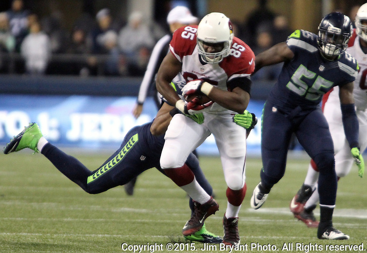 Seattle Seahawks linebacker K.J. Wright (50) brings down  Arizona Cardinals tight end Darren Fells (85) at CenturyLink Field in Seattle, Washington on November 15, 2015. The Cardinals beat the Seahawks 39-32.   ©2015. Jim Bryant photo. All Rights Reserved.