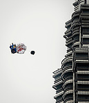 Red Bull Air Force Winsuit jumpers Miles Daisher and Jon DeVore flight between the the Petronas Twin Towers on 22 October 2012,  in Kuala Lumpur, Malaysia. Photo by Victor Fraile / The Power of Sport Images