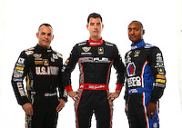 Jan 15, 2015; Jupiter, FL, USA; NHRA top fuel dragster drivers Tony Schumacher (left), Spencer Massey (center) and Antron Brown pose for a portrait during preseason testing at Palm Beach International Raceway. Mandatory Credit: Mark J. Rebilas-USA TODAY Sports