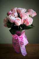 A Stunning arrangement of baby pink roses in a matching vase