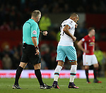 Referee Jonathan Moss times the substitution of Dimitri Payet of West Ham United during the Premier League match at the Old Trafford Stadium, Manchester. Picture date: November 27th, 2016. Pic Simon Bellis/Sportimage