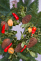 Holiday decorations wreath Christmas, pinecone, pepper, holly Ilex foliage