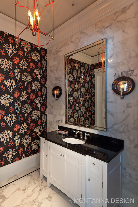 Formal Powder Bath has a pop of coral with the chandelier that leads your eye to<br />