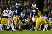 Irish quarterback Tommy Rees (11) signals in the first quarter.