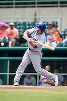 Midland RockHounds outfielder Jaycob Brugman (9) swings the bat during the Texas League baseball game against the San Antonio Missions on June 28, 2015 at Nelson Wolff Stadium in San Antonio, Texas. The Missions defeated the RockHounds 7-2. (Andrew Woolley/Four Seam Images)