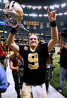 New Orleans Saints QB Drew Brees (9) celebrates after an NFL football game with the New England Patriots in the Louisiana Superdome, Monday, Nov 30, 2009.