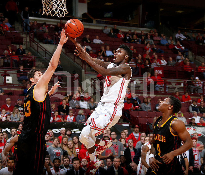 Kam Williams (15) of the Ohio State Buckeyes leaps for a basket while guarded by Ugur Hortum (33) and Remond Brown (4) of the Grambling State Tigers during Tuesday's NCAA Division I basketball game at Value City Arena in the Jerome Schottenstein Center in Columbus on November 17, 2015.  (Barbara J. Perenic/The Columbus Dispatch)