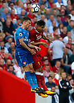 Liverpool's Marko Grujic (R) in action with Arsenal's Laurent Koscielny during the premier league match at Anfield Stadium, Liverpool. Picture date 27th August 2017. Picture credit should read: Paul Thomas/Sportimage