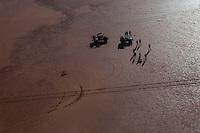Camel catchers in toyota on desert claypan, aerial, Central Australia, Northern Territory, Australia.