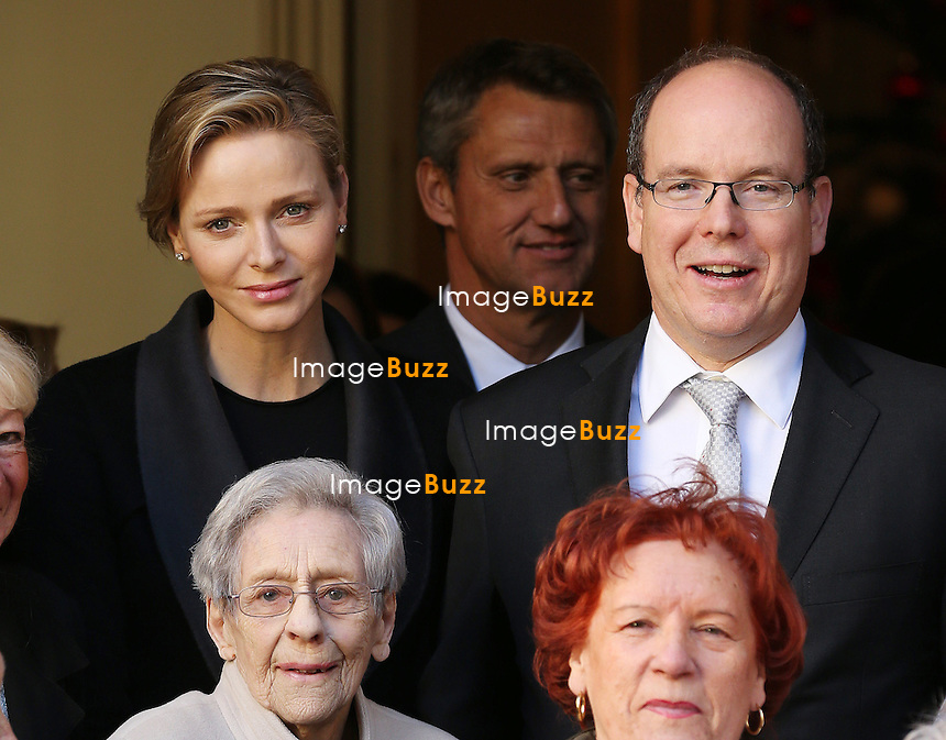 Prince Albert of Monaco and Princess Charlene make the annual Christmas visit to the Red Cross day care centre.<br /> The Couple also handed out presents at the Monaco Red Cross headquarters.<br /> Monaco, December 17, 2013.