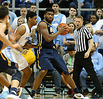 28 December 2015: UNC Greensboro's Kayel Locke (right) backs in against North Carolina's Isaiah Hicks (4). The University of North Carolina Tar Heels hosted the UNC Greensboro Spartans at the Dean E. Smith Center in Chapel Hill, North Carolina in a 2015-16 NCAA Division I Men's Basketball game. UNC won the game 96-63.