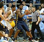 28 December 2015: UNC Greensboro's Kayel Locke (right) backs in against North Carolina's Isaiah Hicks (4). The University of North Carolina Tar Heels hosted the UNC Greensboro Spartans at the Dean E. Smith Center in Chapel Hill, North Carolina in a 2015-16 NCAA Division I Men's Basketball game. UNC won the game 96-63.