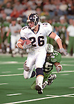 BYU's #26 Luke Staley (RB) runs after a catch.<br /> <br /> Marshall beat BYU 21-3 in the 1999 Motor City Bowl<br /> <br /> December 27, 1999   Detroit, Mich<br /> <br /> Photo by Mark A. Philbrick/BYU<br /> <br /> (801)422-7322     photo@byu.edu
