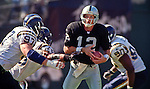 Oakland Raiders vs. San Diego Chargers at Oakland Alameda County Coliseum Sunday, October 11, 1998.  Raiders beat Chargers  7-6.  San Diego Chargers defensive tackle John Parrella (97) and linebacker Junior Seau (55) rush Oakland Raiders quarterback Donald Hollas (12).