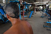 A young Cuban man stands in a bodybuilding gym in Alamar, a public housing complex in the Eastern Havana, Cuba, 9 February 2011.