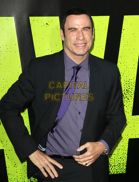John Travolta.The World Premiere of 'Savages' held at The Grauman's Chinese Theatre in Hollywood, California, USA..June 25th, 2012.half length purple hand on hip shirt black suit.CAP/ADM/KB.©Kevan Brooks/AdMedia/Capital Pictures.