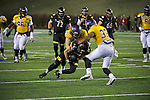 SALEM, VA - DECEMBER 16:  Keith Reineke (21) of the University of Mary Hardin-Baylor tackles Chad Redmer (18) of the University of Wisconsin-Oshkosh during the Division III Men's Football Championship held at Salem Stadium on December 16, 2016 in Salem, Virginia.   Mary Hardin-Baylor defeated the University of Wisconsin-Oshkosh 10-7 for the national title. (Photo by Don Petersen/NCAA Photos via Getty Images)