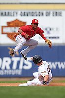 Harrisburg Senators shortstop Wilmer Difo (18) turns a double play as Drew Longley (38) slides in during a game against the Erie Seawolves on August 30, 2015 at Jerry Uht Park in Erie, Pennsylvania.  Harrisburg defeated Erie 4-3.  (Mike Janes/Four Seam Images)
