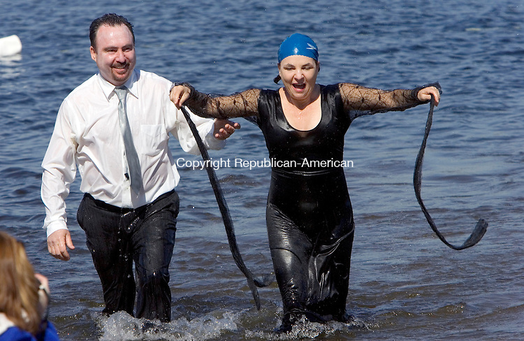 """MIDDLEBURY, CT. 10 March 2012-031112SV08-Tom Spillane of Waterbury and Ellie Stankus of Watertown take the plunge dressed as the, """"Adams Family"""", at Lake Quassapaug Amusement Park during the Special Olympics Penguin Plunge in Middlebury Sunday.  .Steven Valenti Republican-American"""