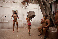 Pehlwani (traditional Indian wrestlers) trains in the early morning using traditional Kushti equipment in the Kolkata akhara (training hall for professional fighters).