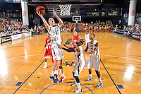 28 January 2012:  FIU center Gilles Dierickx (15) puts up a basket in the second half as the Western Kentucky University Hilltoppers defeated the FIU Golden Panthers, 61-51, at the U.S. Century Bank Arena in Miami, Florida.