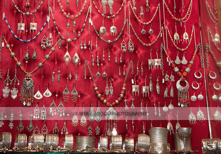 A jewelry store in the Tunis Medina (old city) displays silver necklaces, bracelets, and earrings.