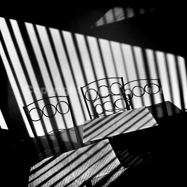 Shiny sunlight stripes are seen on the wall and on the table during the morning in an apartment in Quito, Ecuador, 22 June 2014.