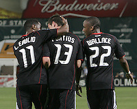 Luciano Emilio #11, Chris Pontius #13 and Rodney Wallace #22 of D.C. United after Pontiius had scored the second goal during an international friendly match against A.C. Milan at RFK Stadium, on May 26 2010 in Washington DC. United won 3-2.