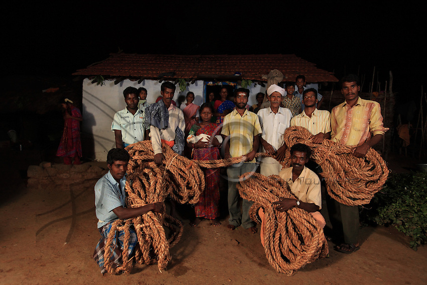 All the honey hunters have gathered for the party organized by Then Mari's household. The firstborn sone of Karupanraj, 26 and his wife Madevi, 24, will be named in the presence of the new rope. He will be called Cowsalliya after his grandfather. It's also the name of a trendy Bollywood actor, and the word for the scent of a flower. Karypanraj will take part in the honey hunt with his uncle Then Mari. Karupanraj's father used to be a honey hunter.