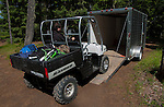 Loading or unloading side-byside UTV with enclosed trailer