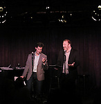 Seth Rudetsky and Hunter Bell performing at the Seth Rudetsky Book Launch Party for 'Seth's Broadway Diary' at Don't Tell Mama Cabaret on October 22, 2014 in New York City.