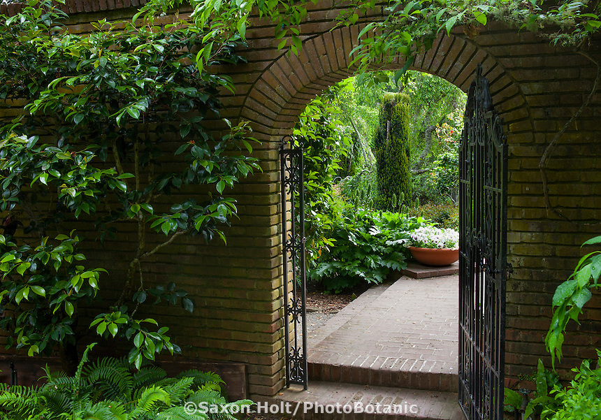 "Open iron gate entry into brick patio secret garden from the Woodland Garden to the ""Wedding Place"" at Filoli"
