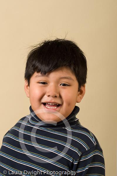 preschool age boy age 4 or 5 closeup headshot portrait smiling vertical