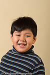 preschool age boy age 4 or 5 closeup headshot portrait smiling vertical