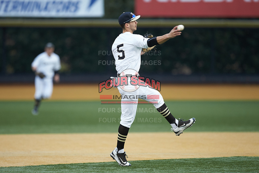 Wake Forest Demon Deacons second baseman Patrick Frick (5) makes a throw to first base against the Sacred Heart Pioneers at David F. Couch Ballpark on February 15, 2019 in  Winston-Salem, North Carolina.  The Demon Deacons defeated the Pioneers 14-1. (Brian Westerholt/Four Seam Images)
