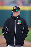 Dayton Dragons pitching coach Tom Browning (32) walks to the dugout from the bullpen before a game against the Great Lakes Loons on May 21, 2015 at Fifth Third Field in Dayton, Ohio.  Great Lakes defeated Dayton 4-3.  (Mike Janes/Four Seam Images)