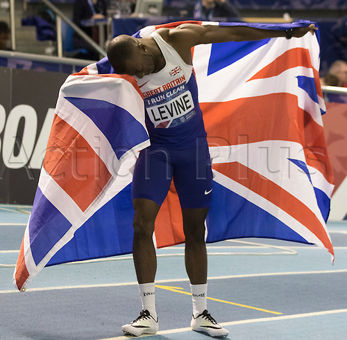 28.02.2016. EIS Sheffield, Sheffield, England. British Indoor Athletics Championships Day Two. Nigel Levine (WSE Houns) poses with a Union Jack after winning the British 400m title.
