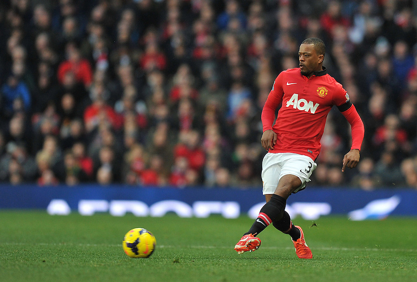 Manchester United's Patrice Evra<br /> <br /> Photo by Dave Howarth/CameraSport<br /> <br /> Football - Barclays Premiership - Manchester United v Fulham - Sunday 9th February 2014 - Old Trafford - Manchester<br /> <br /> &copy; CameraSport - 43 Linden Ave. Countesthorpe. Leicester. England. LE8 5PG - Tel: +44 (0) 116 277 4147 - admin@camerasport.com - www.camerasport.com